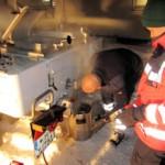 Wasser wird in der Feldküche erhitzt. Foto: JUH