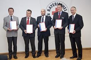 Die fünf BRK-Kreisgeschäftsführer Kurt Stemmer (Traunstein), Martin Schmidt (Rosenheim), Marc Elsner (Mühldorf), Tobias Kurz (Berchtesgadener Land) und Josef Jung (Altötting, von links). (Foto: BRK)
